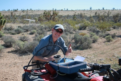 Graduate student Rory O'Connor measuring the water potential of creosote bush in the Mojave Desert.